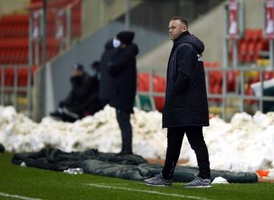 Wayne Rooney watching on.