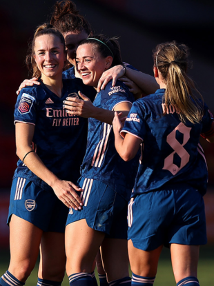 Katie McCabe celebrating with her team-mates.