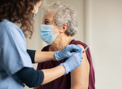 File photo of a nurse vaccinating a patient