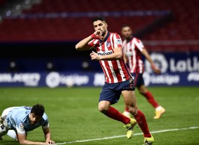 Luis Suarez celebrates his first goal.