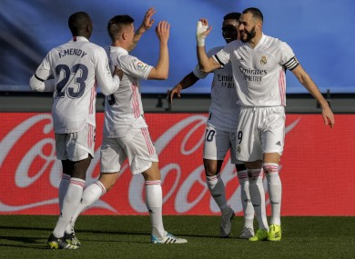 Players celebrate after Karim Benzema scores for Real Madrid.