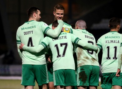 Shane Duffy celebrates with his Celtic team-mates.