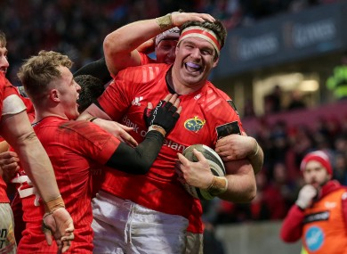 Billy Holland celebrates a try for Munster.