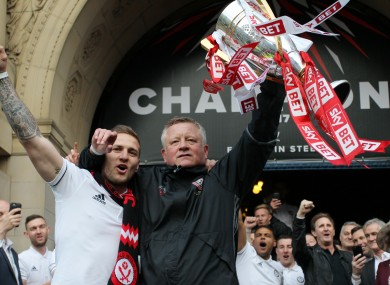 Chris Wilder lifting the League One trophy with Billy Sharp in 2017.