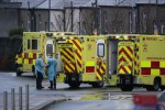 Medics in PPE and ambulances outside the ED at the Mater Hospital in Dublin
