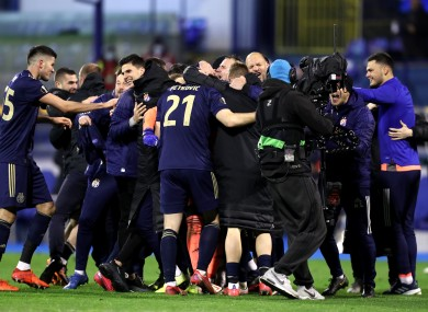 Dinamo Zagreb players celebrate at the full-time whistle.
