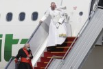 Pope Francis walks down the steps of an airplane as he arrives at Baghdad international airport, Iraq