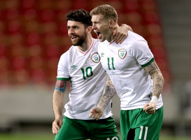 Robbie Brady and James McClean celebrate Ireland's goal.