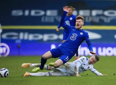 Chelsea's Timo Werner is tackled by Leeds United's Ezgjan Alioski.