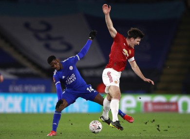 Leicester City's Kelechi Iheanacho and Manchester United's Harry Maguire battle for the ball.