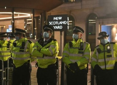 Police officers outside New Scotland Yard in London.