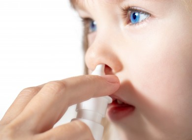 File photo of a child using nasal spray