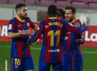 Lionel Messi celebrates with his Barcelona team-mates.