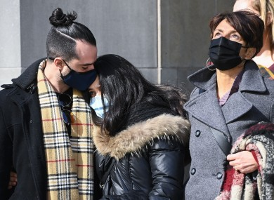 Family members of the dedeceased share a moment outside court.