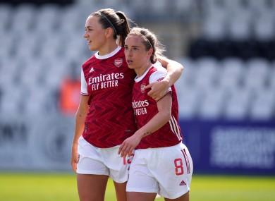 Katie McCabe celebrates with Arsenal goalscorer Jordan Nobbs.