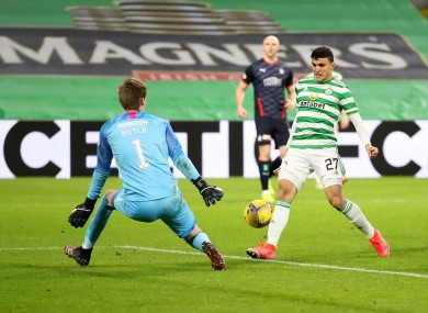 Mohamed Elyounoussi gets Celtic's third.