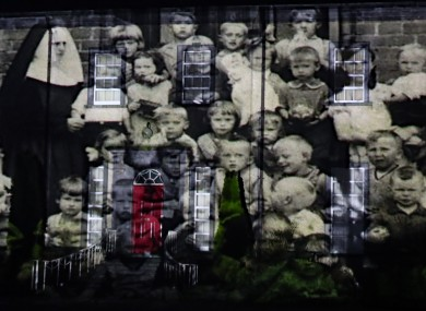 A picture from a mother and baby home is projected onto Sean Ross Abbey in Tipperary as part of the Herstory Light Show to mark St Brigid's Day in February.
