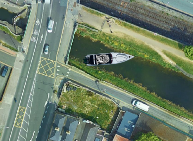 An aerial image showing the statue of Kelly in the beleaguered barge.