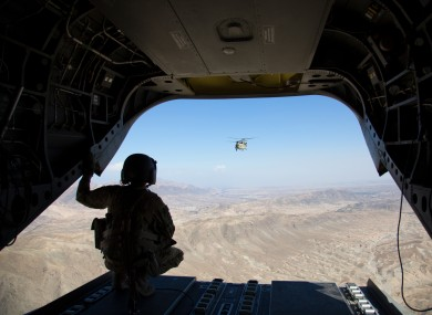A soldier form the US 101st Airbone looks out at the partner Chinook following during a resupply mission in Jalalabad. October 2018.
