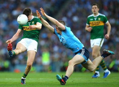 Sean O'Shea is charged down by John Small during the 2019 All-Ireland final replay.