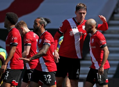 Southampton's Nathan Redmond (right) celebrates scoring their side's third goal of the game with team-mates.