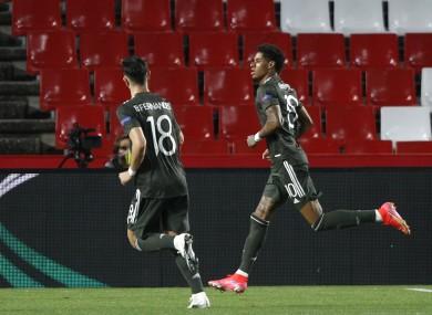 Rashford celebrates after scoring his side's first goal.