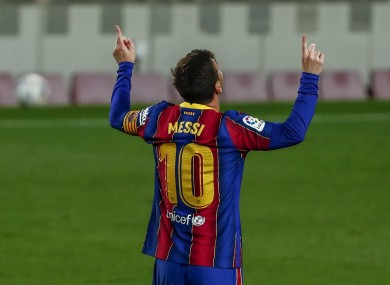 Messi celebrates after scoring his second goal.