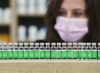 Canadian pharmacist Barbara Violo arranges empty vials of the Oxford-AstraZeneca Covid-19 vaccines that she has provided to customers.