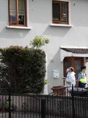 Gardai forensic teams (Technical Bureau) look at the bullet holes in the windows at the scene of a shooting and siege at Whitechapel Grove, Blanchardstown.