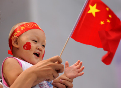 A child waves the Chinese flag during the Olympic Games in Beijing. 10 August 2008.