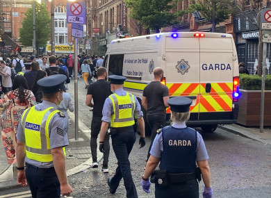 embers of Gardai enforce coronavirus restrictions and move people on from South William St, Dublin