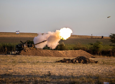 An Israeli artillery unit fires shells towards targets in the Gaza Strip