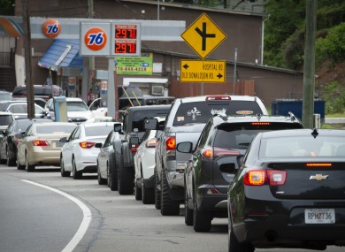 Motorists queue along a highway in North Georgia, hoping to fuel their cars and trucks at a gas station before supplies run dry