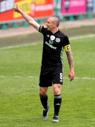 Scott Brown salutes someone in the stand as he says goodbye to Celtic.