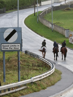 A group of horse riders cross the border from Ireland into Northern Ireland at Carrickcarnan, Co Louth.