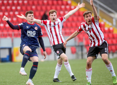 Derry's Joe Thomson and Cameron McJannet appeal for handball against Alfie Lewis of St Pat's.