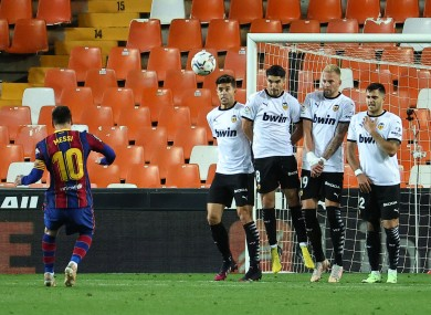 Lionel Messi scores Barcelona's third goal against Valencia