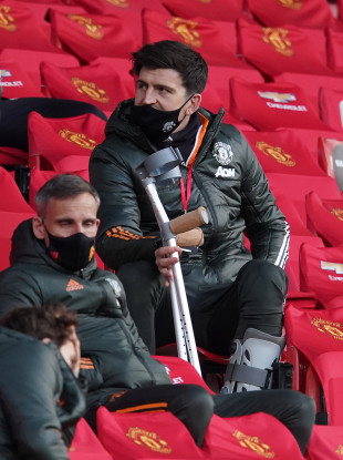 Harry Maguire watching on during the recent Premier League game against Leicester City.