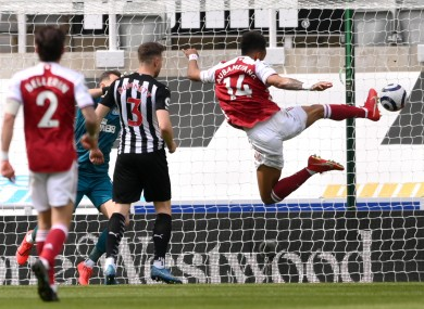 Aubameyang scores his side's second goal against Newcastle.