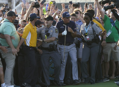 Phil Mickelson tries to move through the crowd on the 18th hole at Kiawah Island.