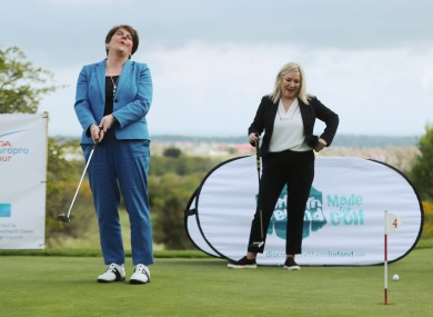 Arlene Foster and Michelle O'Neill at Clandeboye Golf Club yesterday