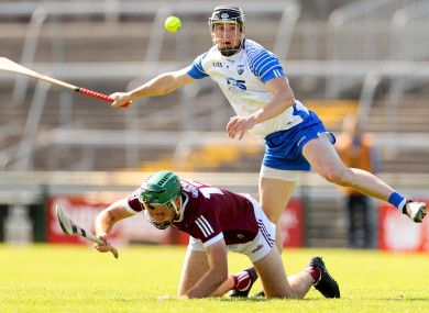 Galway's Brian Concannon and Conor Gleeson of Waterford compete for the ball.