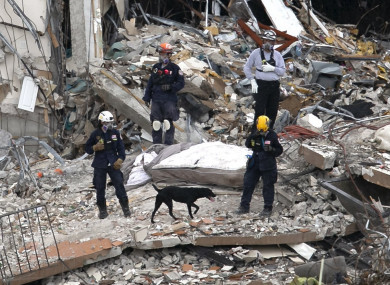 South Florida Urban Search and Rescue team look through rubble for survivors at the partially collapsed Champlain Towers South condo building