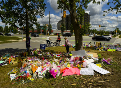 A women visits the scene and a tribute to the victims of the deadly vehicle attack on five members of the Canadian Muslim community in London, Ontario