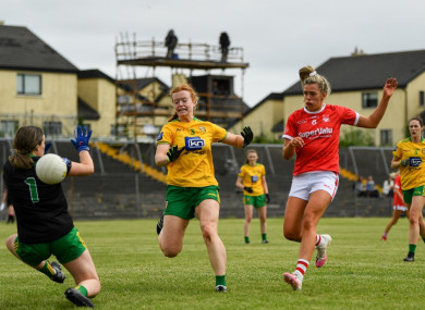 Máire O'Callaghan of Cork shoots to score her side's third goal.