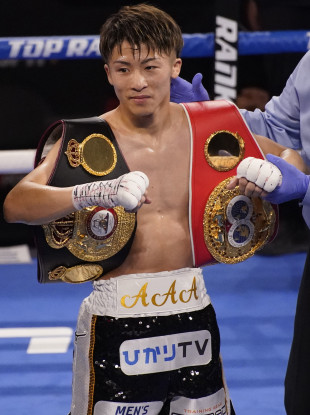 Winner, winner: Naoya Inoue, of Japan, holds up his belts after defeating Michael Dasmarinas.