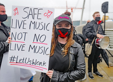 Musician and singer Jenny O'Donovan joins a protest outside the Convention Centre in Dublin, calling for a loosening of coronavirus restrictions.