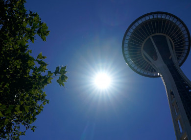 The sun shines near the Space Needle, Monday, June 28, 2021, in Seattle.