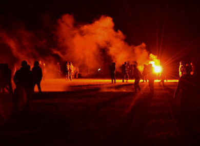 Police repeatedly fired tear gas and charged clusters of partygoers who hurled projectiles at security forces.