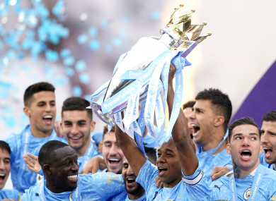 Manchester City celebrate with the trophy.